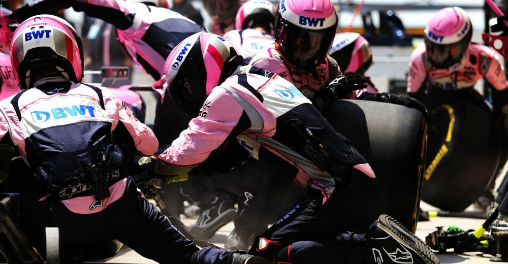 Force India pit crew works hard after smooth pit-stops in China - Picture from Force India media