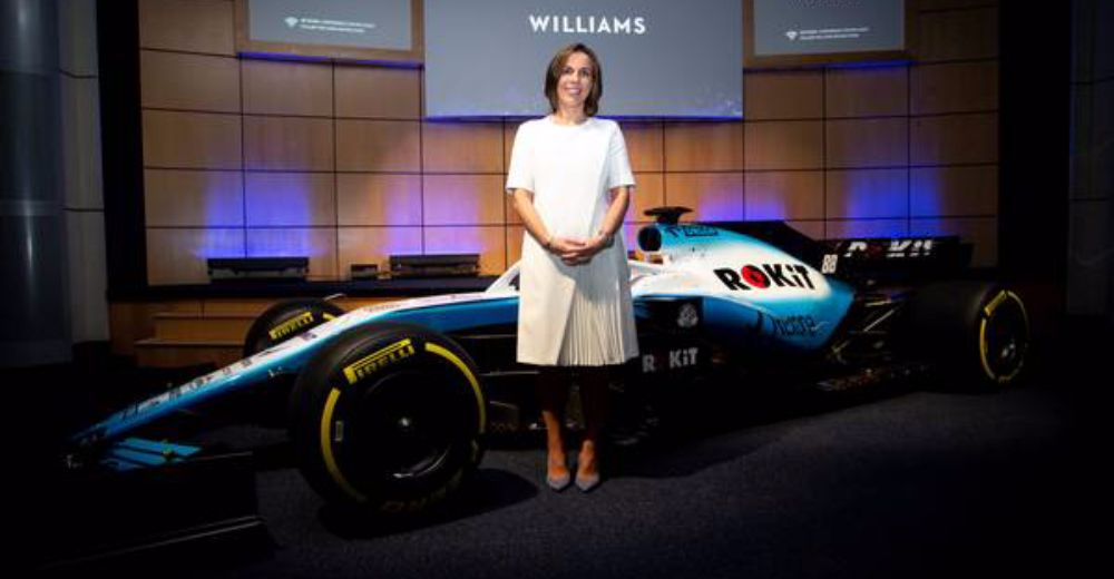 Deputy team principal Claire Williams stands in front of the new car
