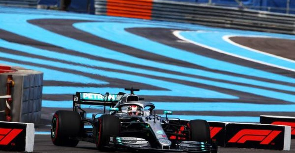 Hamilton runs off at turn four!