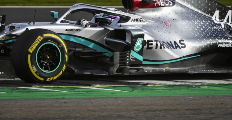 The first image of Lewis Hamilton behind the wheel of the W11!